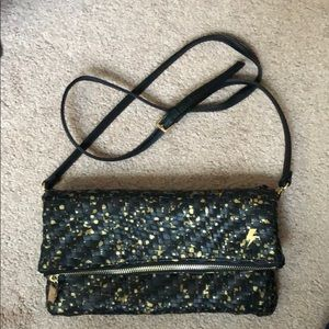 Gold and black fold over purse from Anthropologie